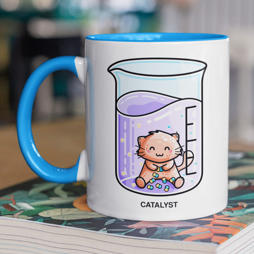 Cute cat joining atoms in a chemistry beaker of liquid design on a two toned blue and white ceramic mug, showing LHS