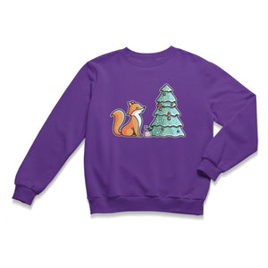 A purple unisex crewneck sweatshirt laid flat with a design of a cute red fox sitting sideways on looking at a decorated Christmas tree and with a present at its feet.