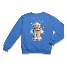 Load image into Gallery viewer, A blue unisex crewneck sweatshirt laid flat with a design of a kawaii cute gingerbread person wearing a blue scarf and with dots of white snow falling from above
