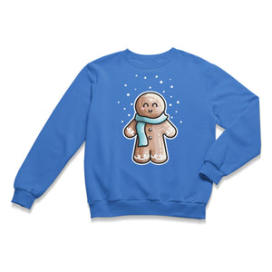 A blue unisex crewneck sweatshirt laid flat with a design of a kawaii cute gingerbread person wearing a blue scarf and with dots of white snow falling from above