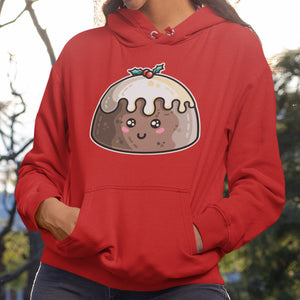 Torso of a woman wearing a red hoodie with her hands in the front pouch and the neck cords tucked away with a design on the chest of a kawaii cute Christmas pudding smiling