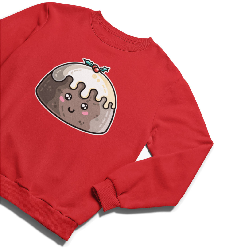 A red unisex crewneck sweatshirt laid flat at an angle with a design of a kawaii cute smiling Christmas pudding with cream poured over the top and a sprig of holly.