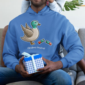 Torso of a black man sitting holding a wrapped gift and wearing a royal blue colour hoodie with the neck cords tucked away and the design on the chest of a duck facing to the right with its wings up and a pulled Christmas cracker at its feet with the words Christmas Quacker written beneath in white