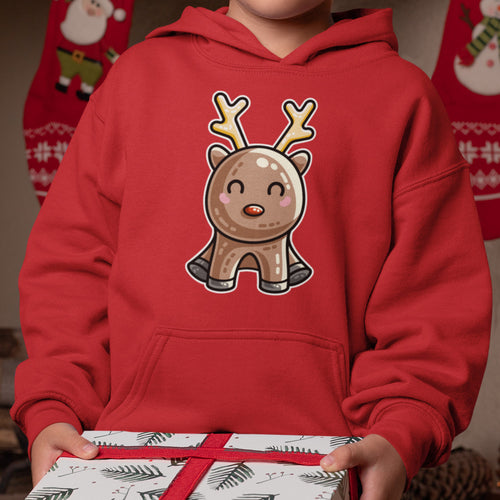 Torso of a child carrying a Christmas present wearing a red hoodie with no neck cords and a design on the chest of a kawaii cute red nosed reindeer in a sitting position