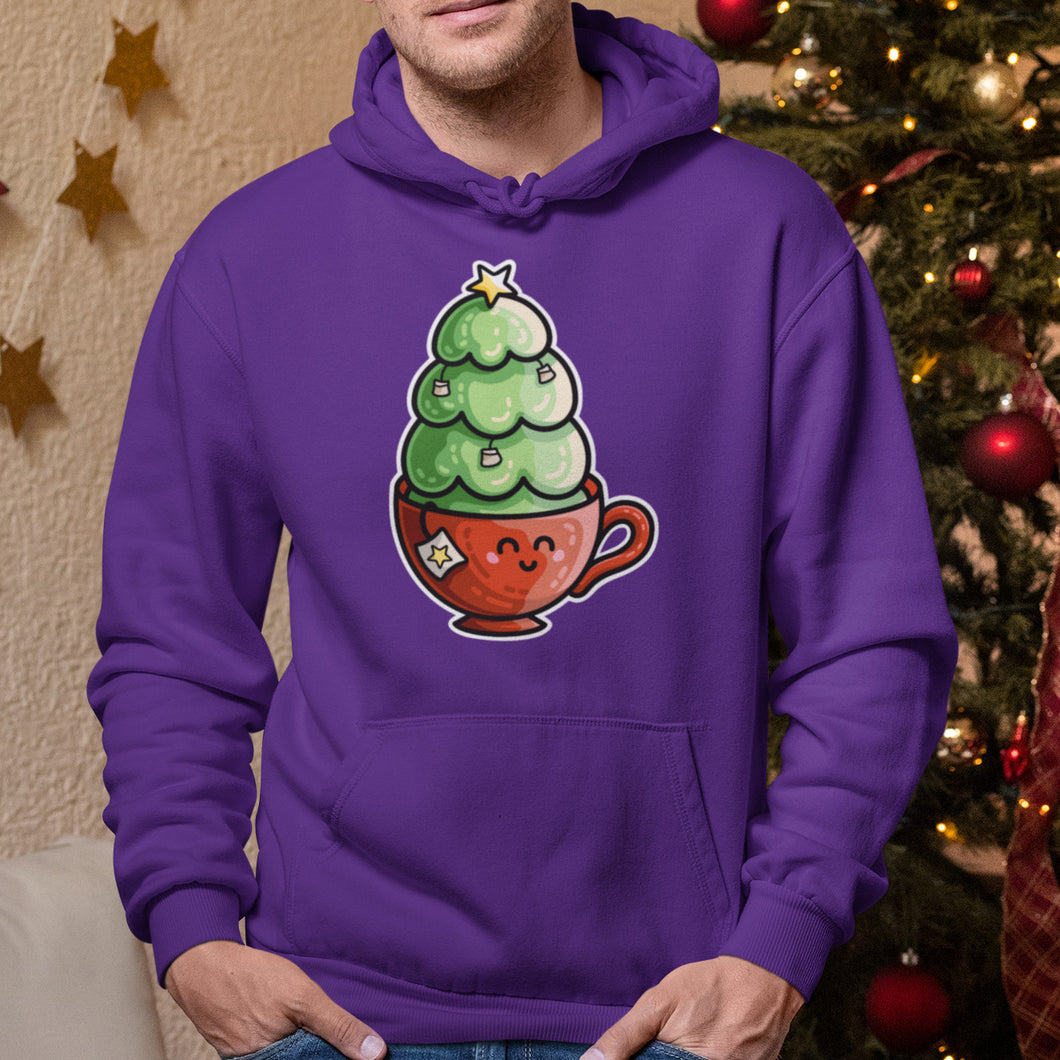 Torso of a man wearing a purple hoodie with his hands in his jeans pockets and neck cords tucked in with a design on the chest above the front pouch of a christmas tree decorated in teabags planted in a kawaii cute red teacup