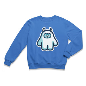 A blue unisex crewneck sweatshirt laid flat with a design of a white yeti figure with horns on its head and a cute smiling face