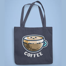 Load image into Gallery viewer, A dark blue coloured fabric tote bag lying flat against a pale blue background with a design in the center of a kawaii cute glass cup of coffee with a thick creamy layer at the top and a smiling face in the cream on the top. The word coffee is in white capital letters in an arc beneath.