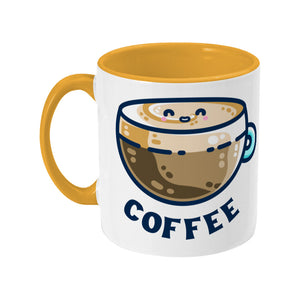 A two toned white and yellow ceramic mug with the handle to the left showing a design of a kawaii cute glass cup of coffee with a thick creamy layer at the top and a smiling face in the cream on the top. The word coffee is in capital letters beneath.
