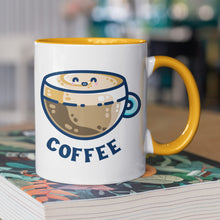 Load image into Gallery viewer, A two toned white and yellow ceramic mug with the handle to the right showing a design of a kawaii cute glass cup of coffee with a thick creamy layer at the top and a smiling face in the cream on the top. The word coffee is in capital letters beneath.
