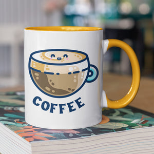 A two toned white and yellow ceramic mug with the handle to the right showing a design of a kawaii cute glass cup of coffee with a thick creamy layer at the top and a smiling face in the cream on the top. The word coffee is in capital letters beneath.
