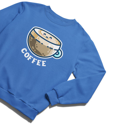 A blue unisex crewneck sweatshirt laid flat at an angle with a design on its chest of a kawaii cute glass cup of coffee with a thick creamy layer at the top and a smiling face in the cream on the top. The word coffee is in white capital letters beneath.