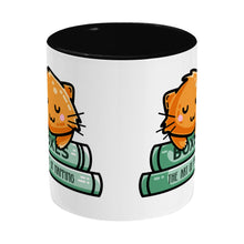 Load image into Gallery viewer, Cute ginger cat asleep on books design on a two toned black and white ceramic mug, side view