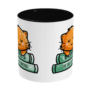 Cute ginger cat asleep on books design on a two toned black and white ceramic mug, side view
