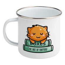 Load image into Gallery viewer, Cute ginger cat asleep on two books design on a silver rimmed white enamel mug, showing LHS