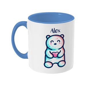 A blue two toned ceramic mug with the name Alex and a polar bear design beneath - back view