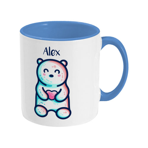 A blue two toned ceramic mug with the name Alex and a polar bear design beneath - front view