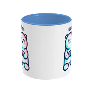 A blue two toned ceramic mug with the name Alex and a polar bear design beneath - side view