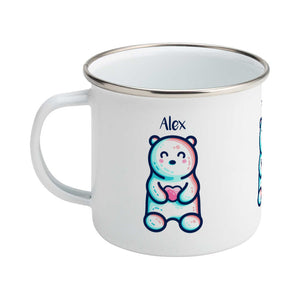 A silver rimmed white enamel mug seen from the back, with the handle to the left, with the personalised name Alex written above the cute polar bear holding a heart