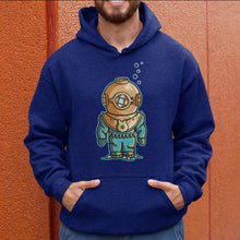Load image into Gallery viewer, Torso of a man wearing an Oxford blue colour hoodie with his hands in the front pouch and the neck cords tucked in with a design on the chest of a vintage style deep sea diver