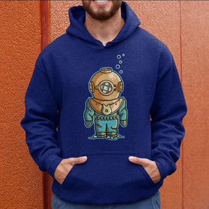 Torso of a man wearing an Oxford blue colour hoodie with his hands in the front pouch and the neck cords tucked in with a design on the chest of a vintage style deep sea diver