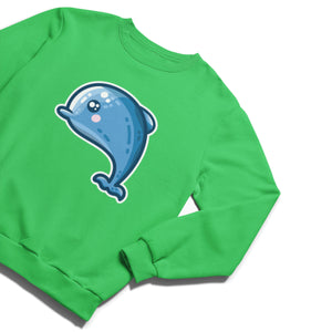 A kelly green unisex crewneck sweatshirt laid flat with a kawaii cute design of a blue dolphin on the chest