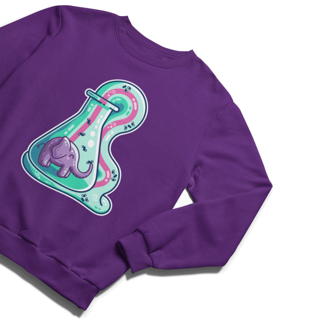 A purple unisex crewneck sweatshirt laid flat with a design on its chest of a purple elephant in a glass conical flask which is overflowing with green and pink striped foam like toothpaste