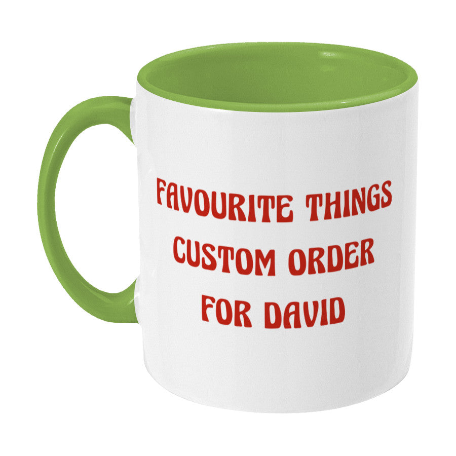 A green and white two toned ceramic mug with handle on the left and the words favourite things custom order for David