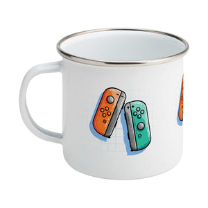 An orange and a turquoise game controller design on a silver rimmed enamel mug, showing LHS