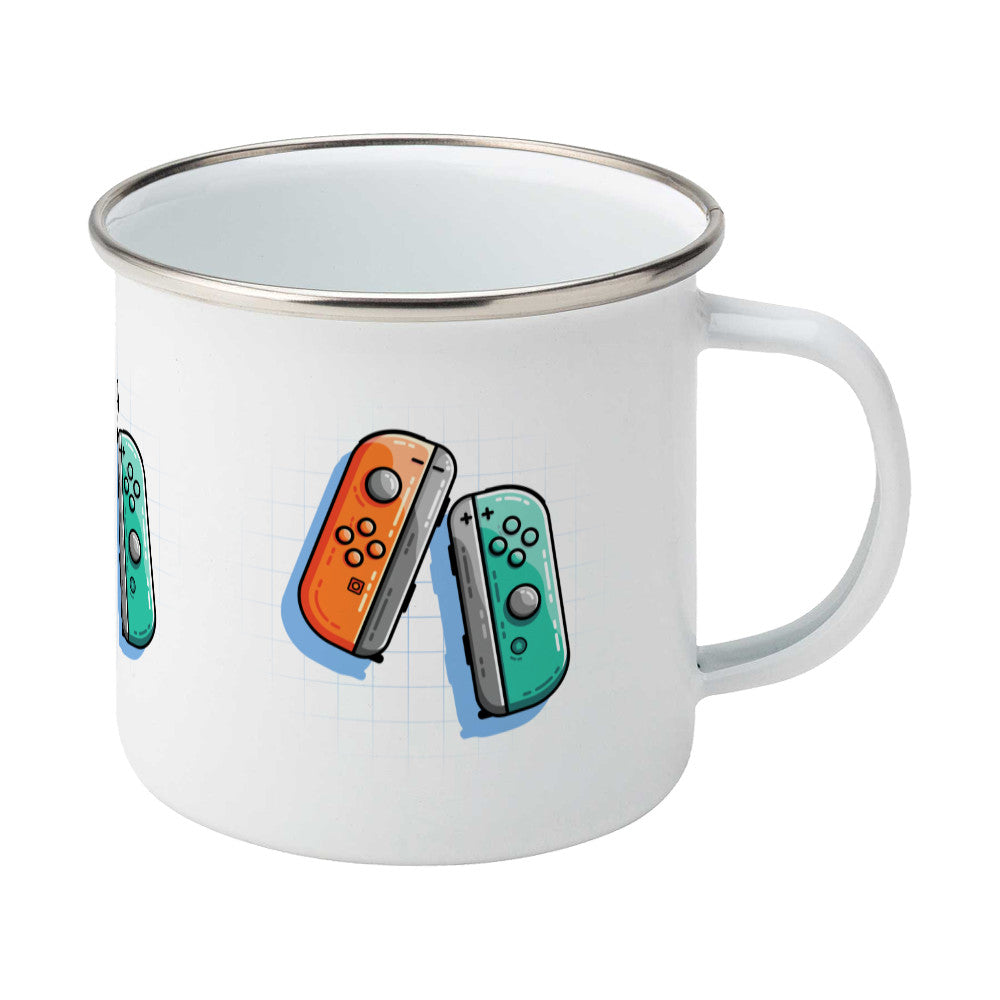 An orange and a turquoise game controller design on a silver rimmed enamel mug, showing RHS
