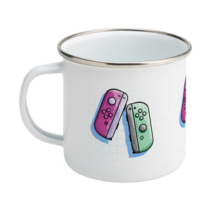 A pink and a green game controller design on a silver rimmed enamel mug, showing LHS