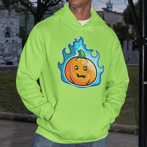 The torso of a black man wearing a lime green hoodie with his hands in the front pouch and the neck cords tucked in with a design on the chest of a kawaii cute orange pumpkin surrounded in blue flames