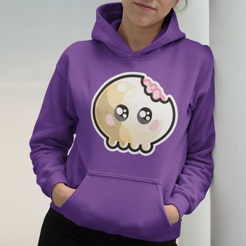 Torso of a woman wearing a purple hoodie with her hands in her pockets and the neck cords tucked away with a design on the chest of a kawaii cute skull with some brains showing through a bite taken out of it