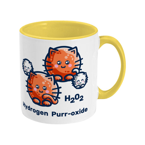 A two toned white and yellow ceramic mug with the handle to the right showing a design of a hydrogen molecule with the hydrogen atoms replaced by round white kittens and the oxygen atoms replaced by larger round ginger cats and the words H202 hydrogen purr-oxide