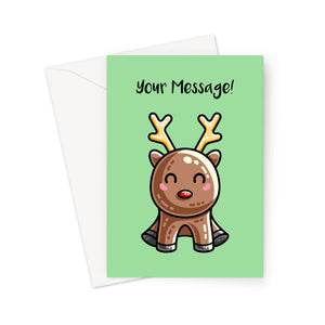 A white envelope beneath a green greeting card with a design of a kawaii cute reindeer with a red nose in a sitting position facing forward and the words Your Message in black above