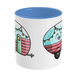 Kawaii cute vintage pastel coloured caravan on a two toned blue and white ceramic mug, side view