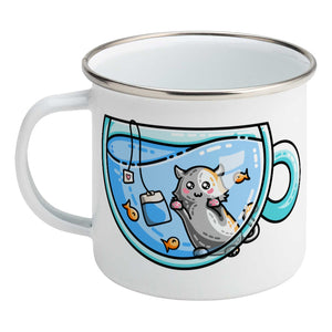 Cute cat watching orange fish swimming in a glass teacup design on a silver rimmed white enamel mug, showing LHS