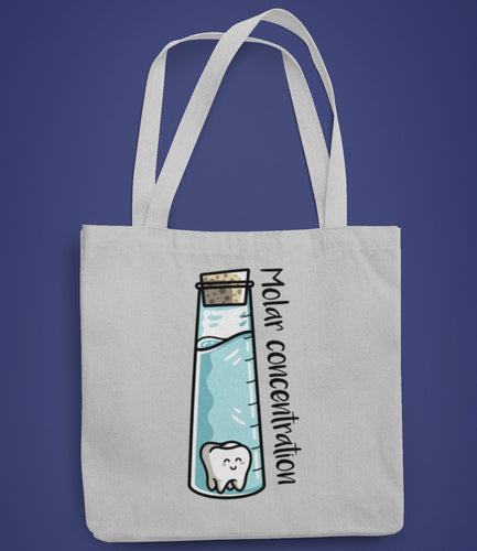 A corked chemistry vessel of liquid containing a molar tooth design on a recycled cotton and polyester tote bag
