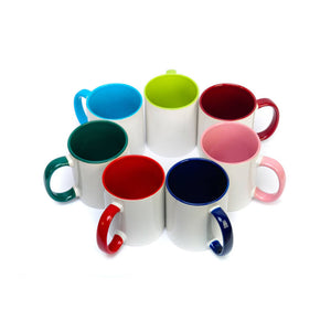 A circle of two toned ceramic mugs seen from above showing the different colours available for the handle and inside of the mugs