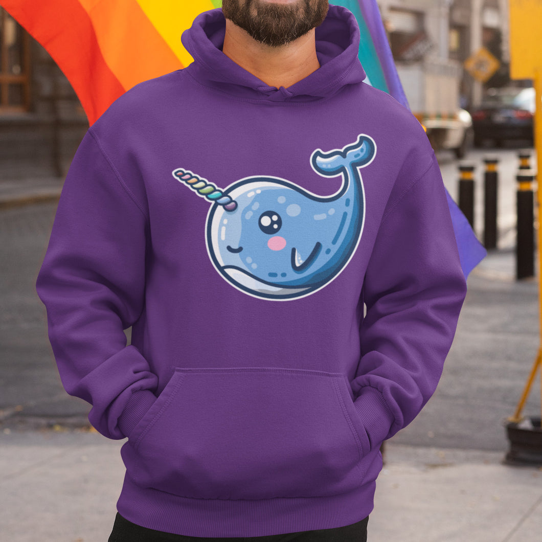 The torso of a man wearing a purple hoodie with his hands in the front pouch and the neck cords tucked in with a design on the chest of a kawaii cute narwhal facing left with a rainbow striped horn