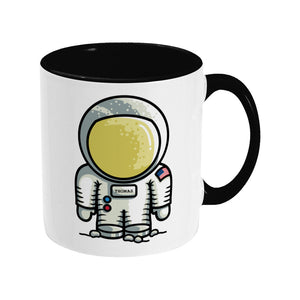 Personalised cute astronaut design on a two toned black and white ceramic mug, showing RHS