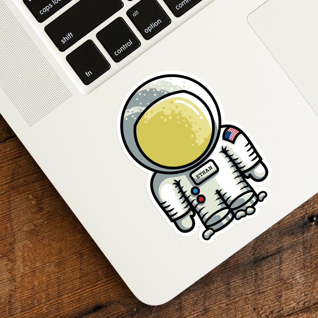 Cute astronaut space suit vinyl sticker on a laptop computer keyboard