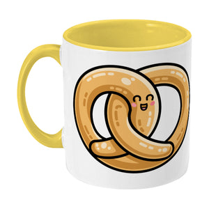 Kawaii cute pretzel design on a two toned yellow and white ceramic mug, showing LHS