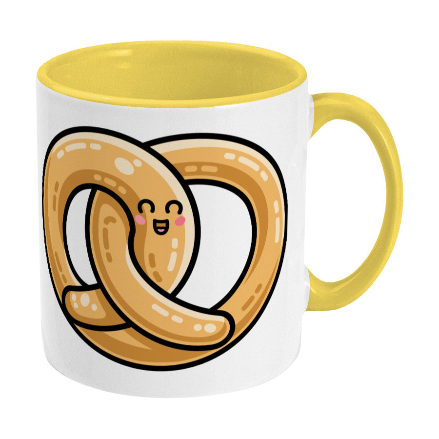 Kawaii cute pretzel design on a two toned yellow and white ceramic mug, showing RHS