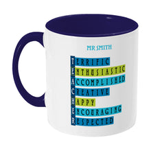 Load image into Gallery viewer, Words representing positive characteristics of teachers and personalised with a name on a two toned blue and white ceramic mug, showing LHS