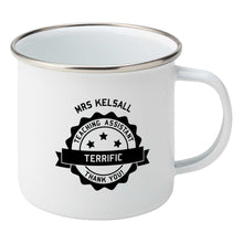 Load image into Gallery viewer, Personalised black circular banner design with the words 'terrific teaching assistant' on a silver rimmed white enamel mug, showing RHS
