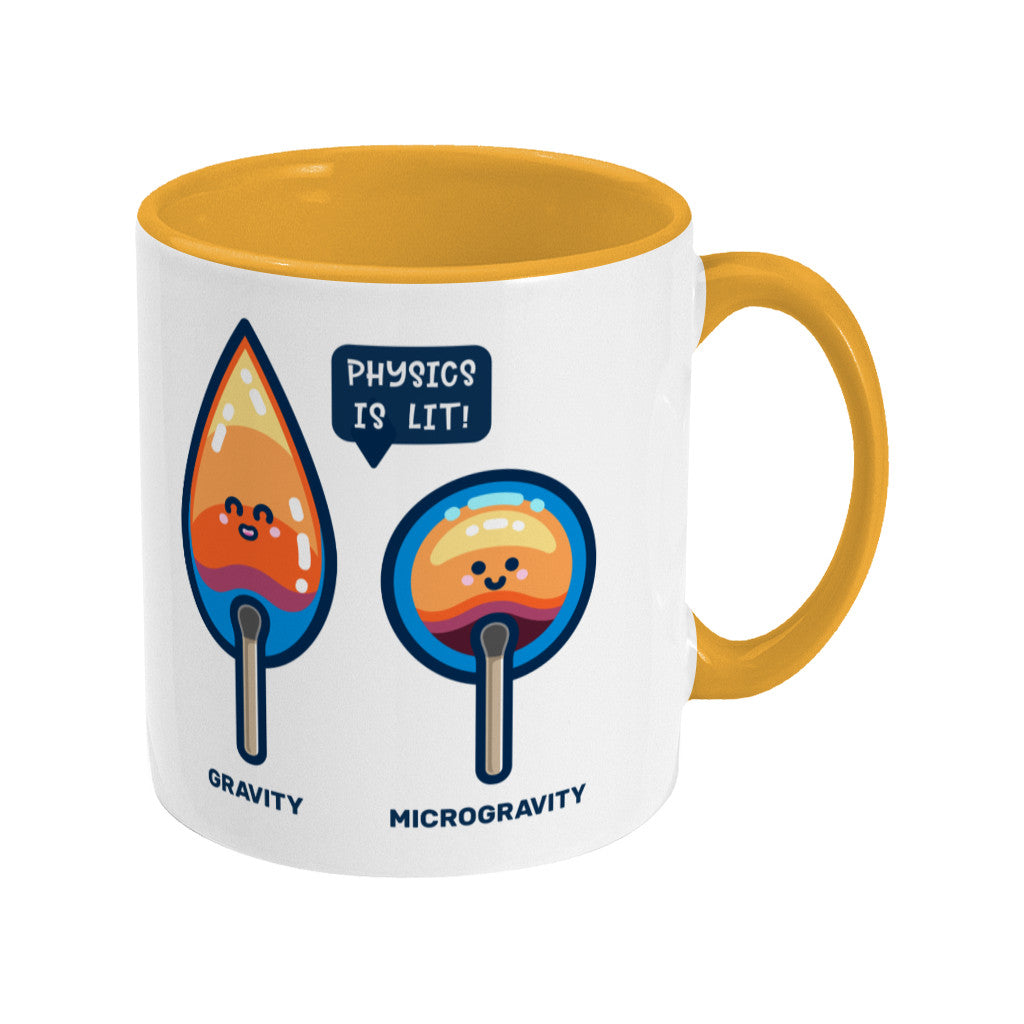 A yellow and white two toned ceramic mug with the handle to the right and a design of two cute flames, one pointed with the word gravity and one circular with the word microgravity and a speech bubble saying physics is lit