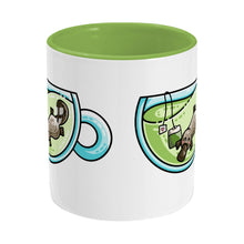 Load image into Gallery viewer, Cute platypus swimming in a glass teacup of green tea design on a two toned green and white ceramic mug, side view