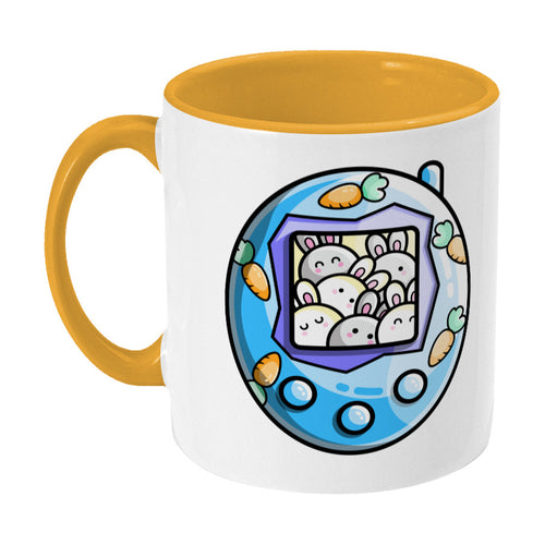 Cute blue rabbit and carrots tamagotchi design on a two toned yellow and white ceramic mug, showing LHS