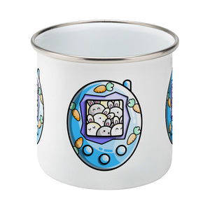 Cute rabbit and carrots blue tamagotchi design on a silver rimmed white enamel mug, side view