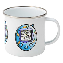 Load image into Gallery viewer, Cute rabbit and carrots blue tamagotchi design on a silver rimmed white enamel mug, showing RHS